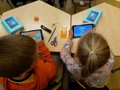 Children using tablets at a daycare