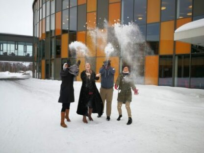 Teachers playing in snow during a study tour